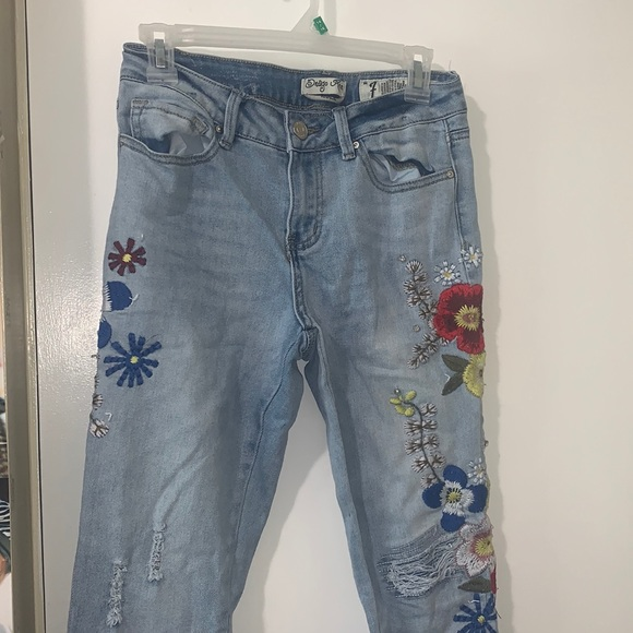 Blue jeans with decorative floral print